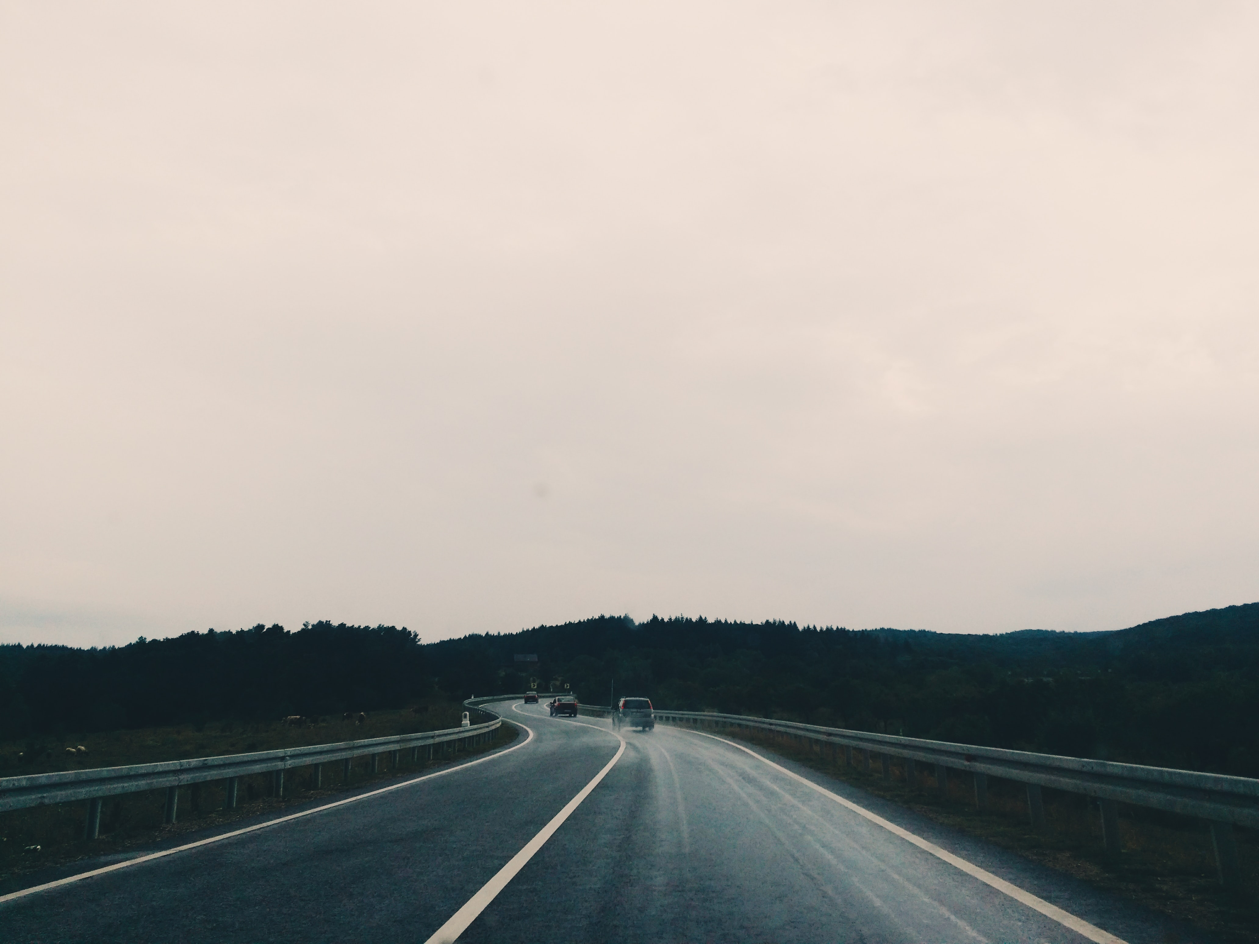 Cars in distance on the highway.