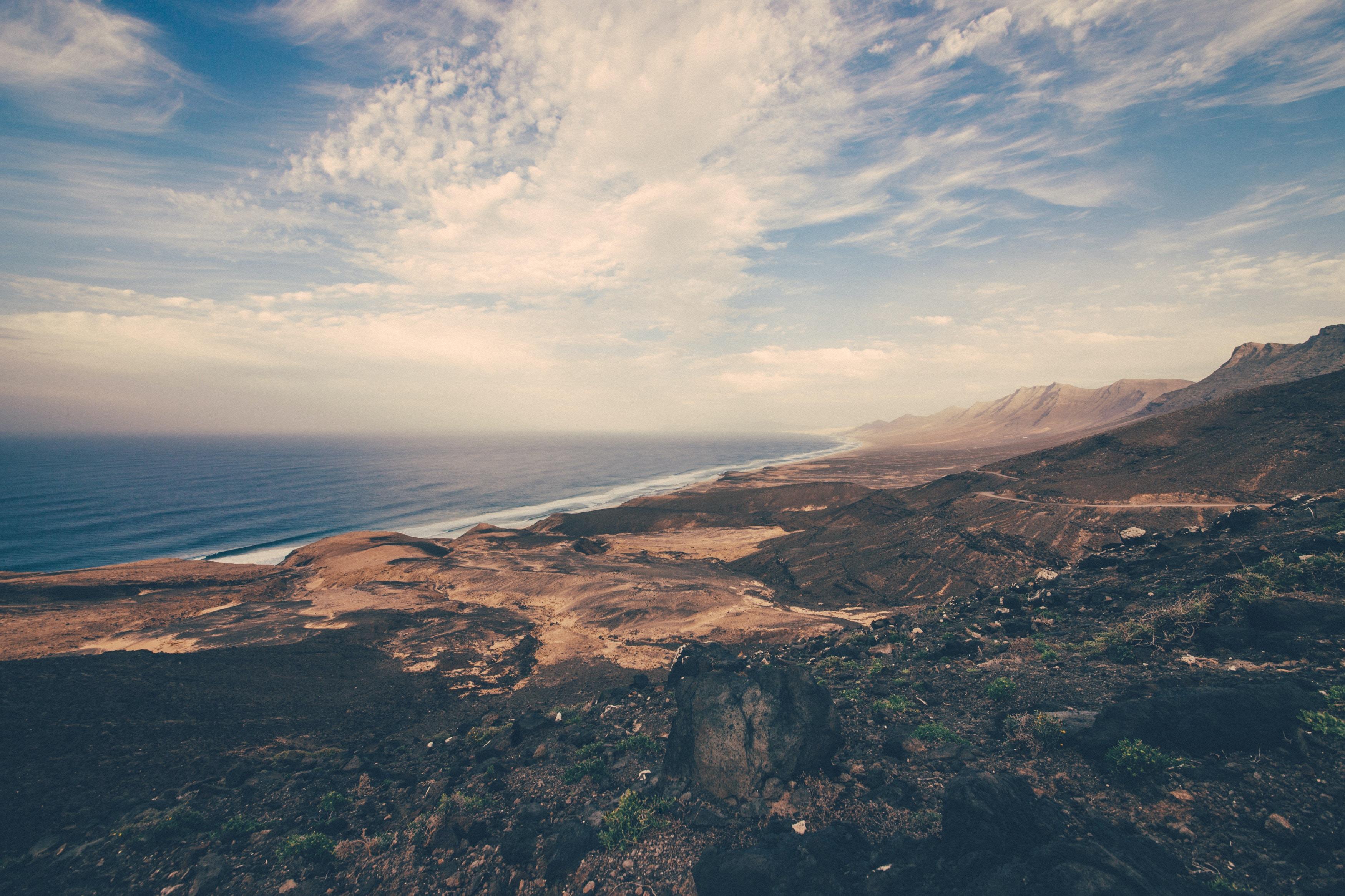 Barren coastline by the mountain range at Cofete
