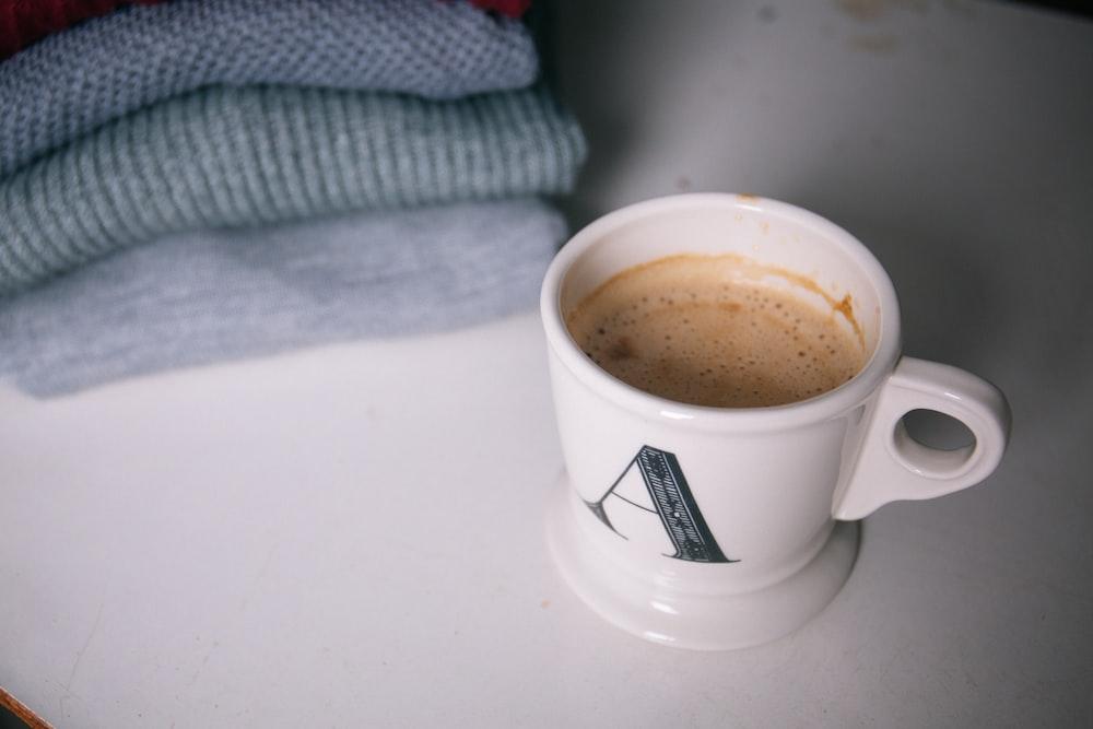 white and grey ceramic mug