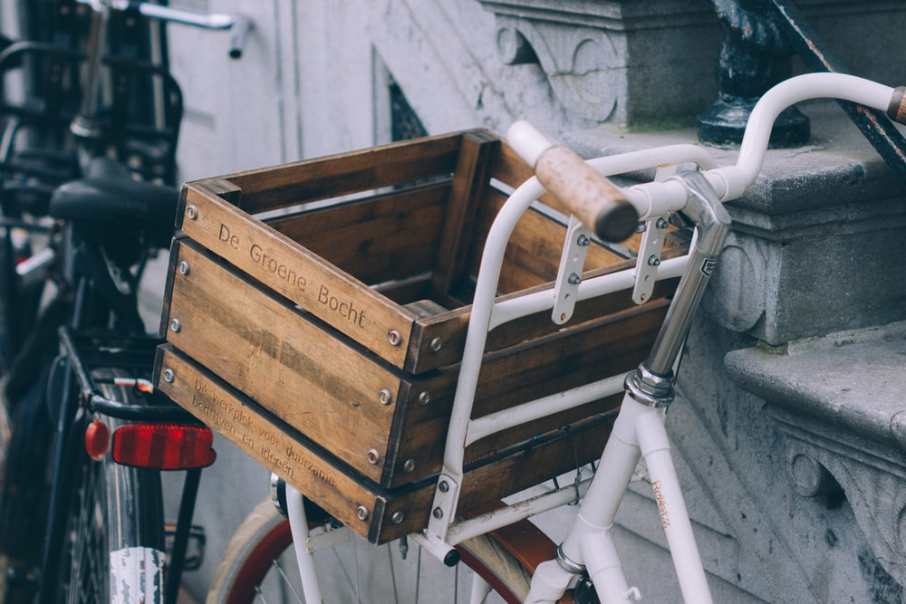 brown wooden crate on white bicycle