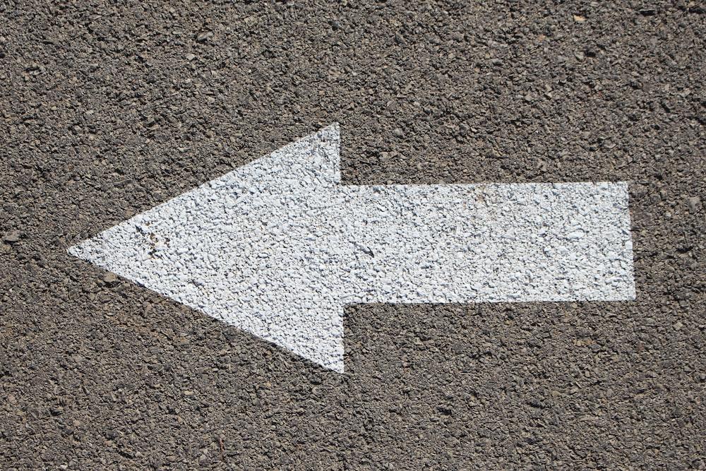white arrow road sign