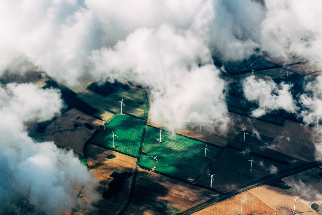 aerial photo of wind turbines near field environment
