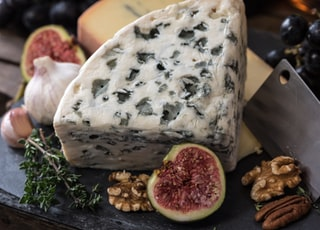 bolognese cheese beside herbs