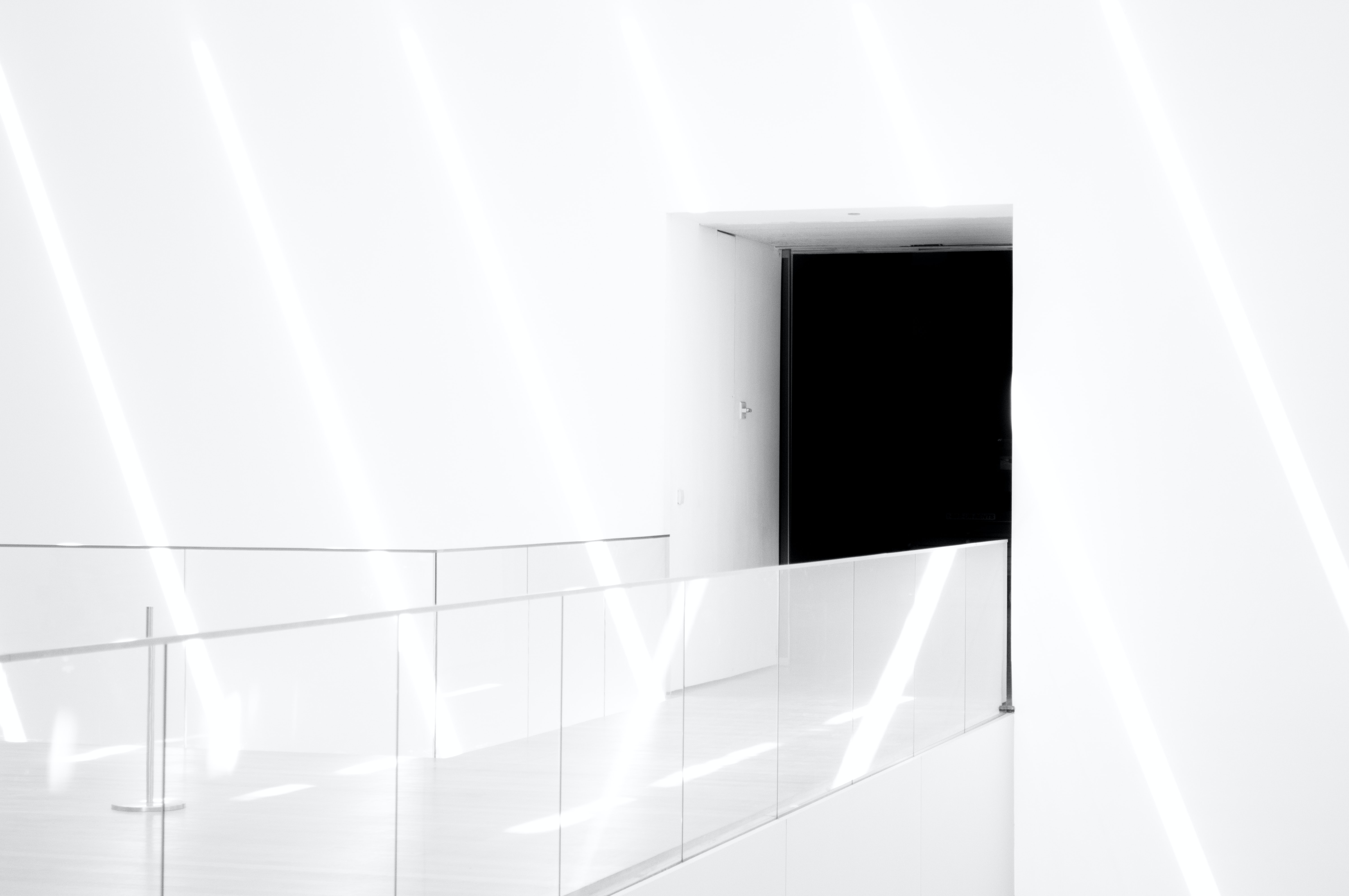 Modern architecture of white hallway passage and black door, The Museum of Modern Art