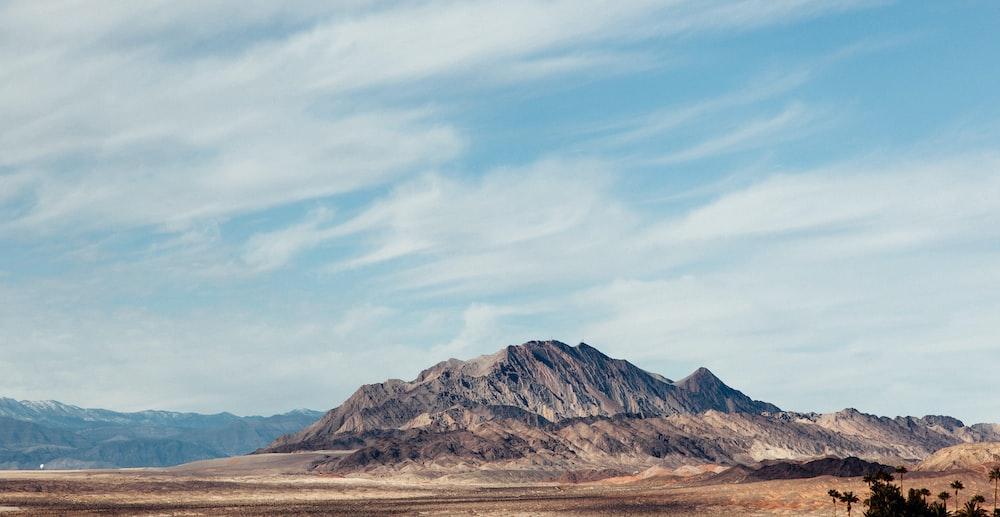 bird's eye view photo of brown mountain