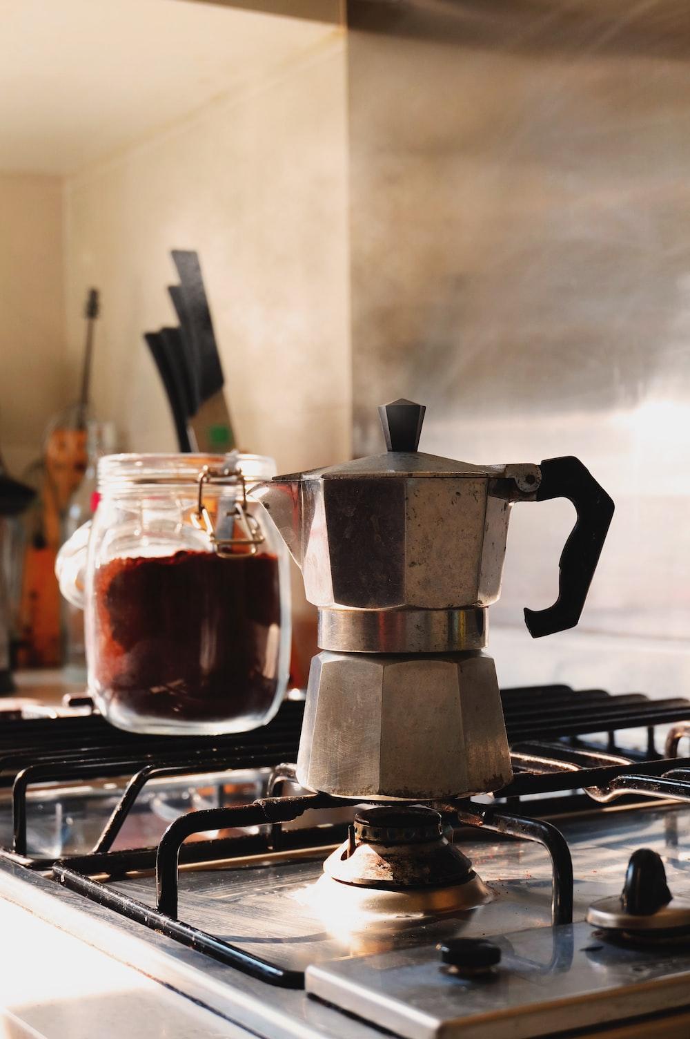gray and black moka pot on top of gray gas range oven