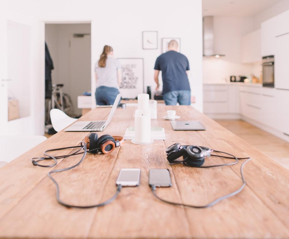 orange and black headphones on table