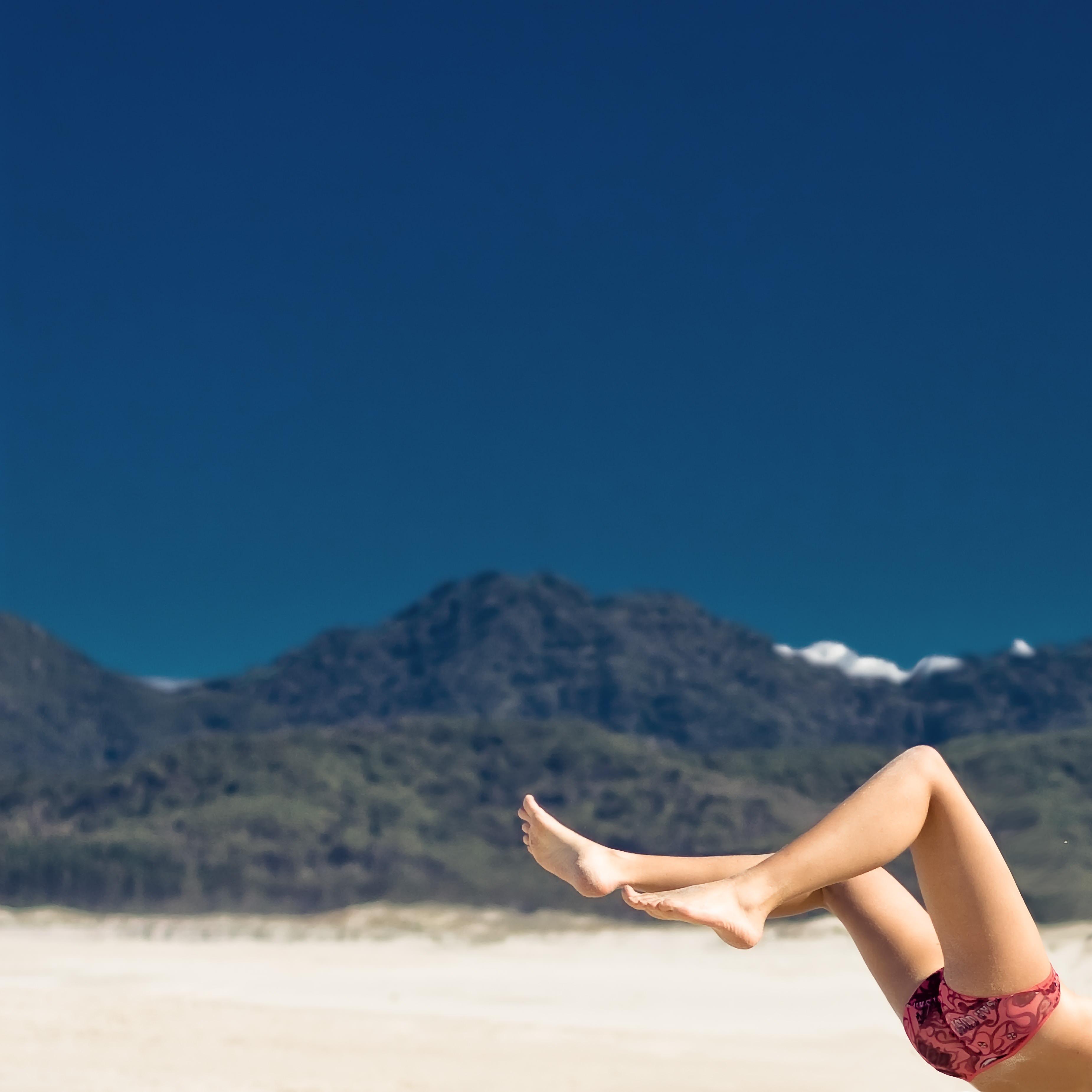 selective focus photography of woman on seashore