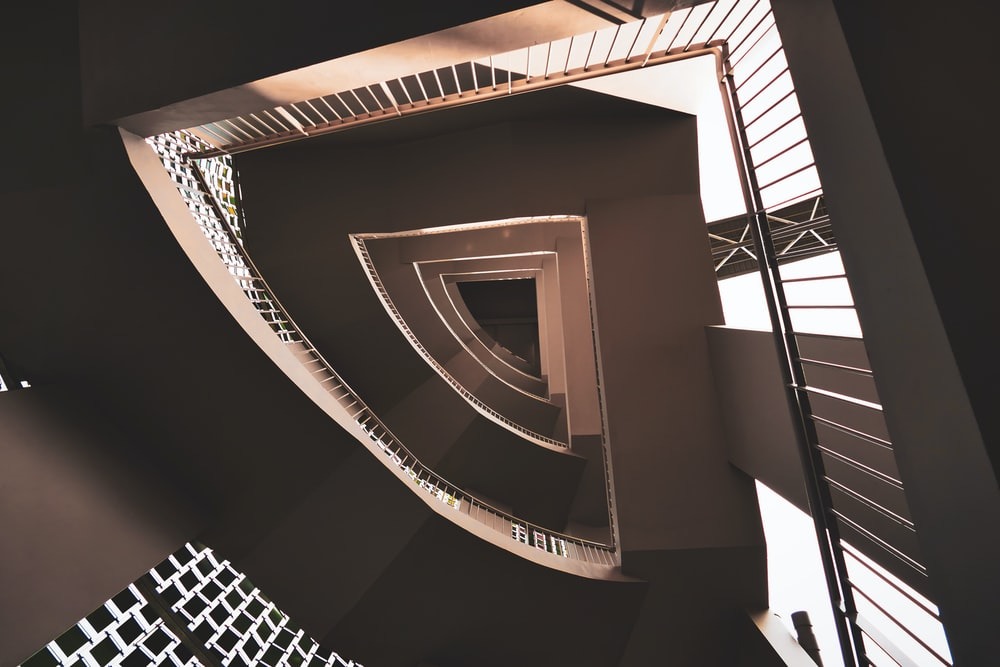 low-angle photography of concrete stair