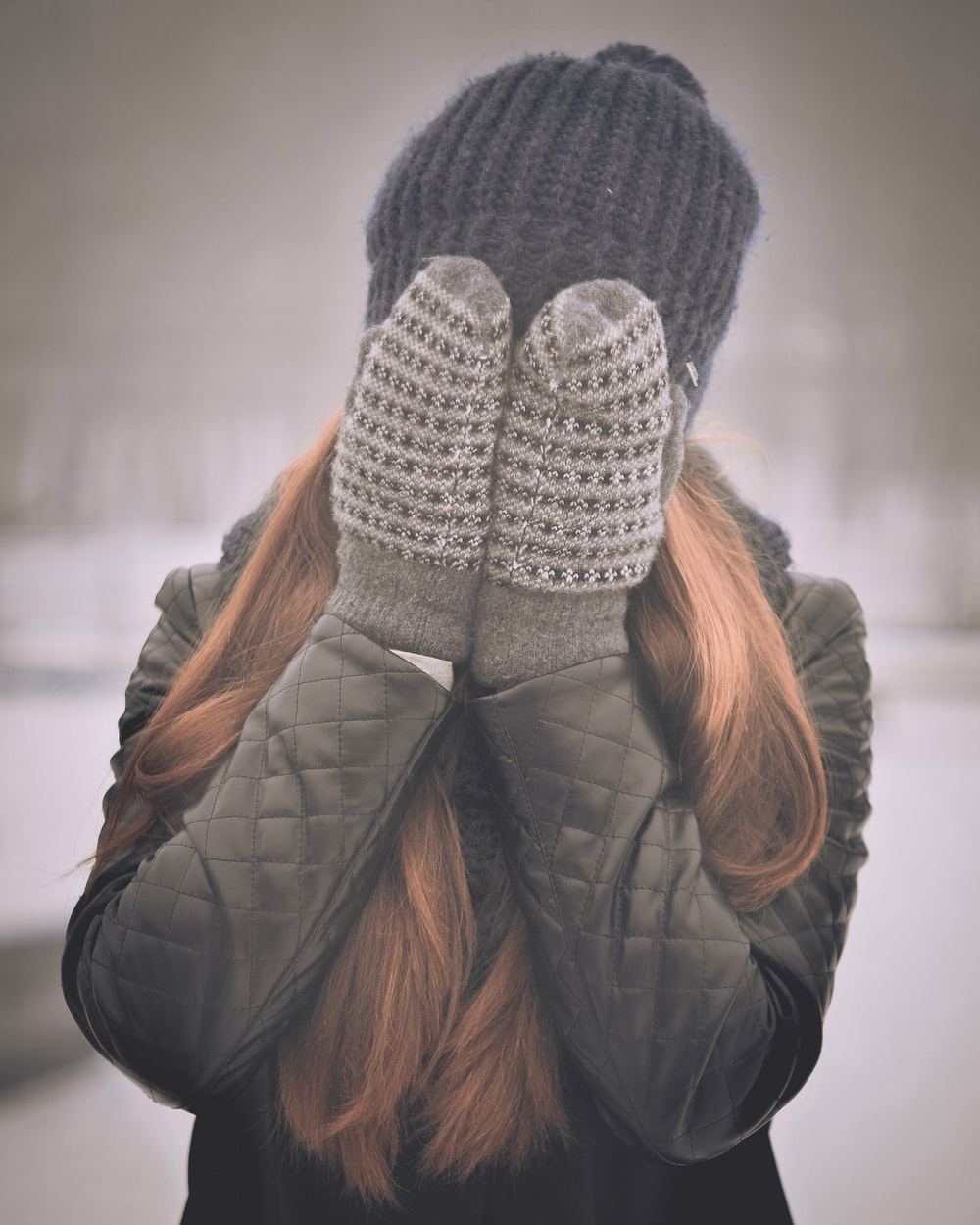 woman covering her face