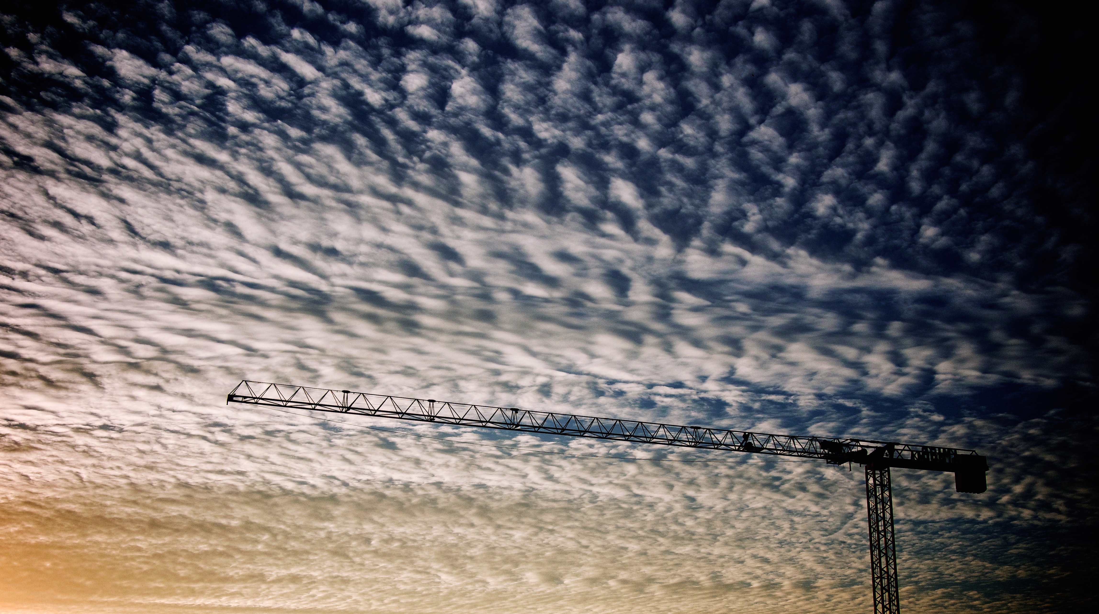 photo of crane and white clouds