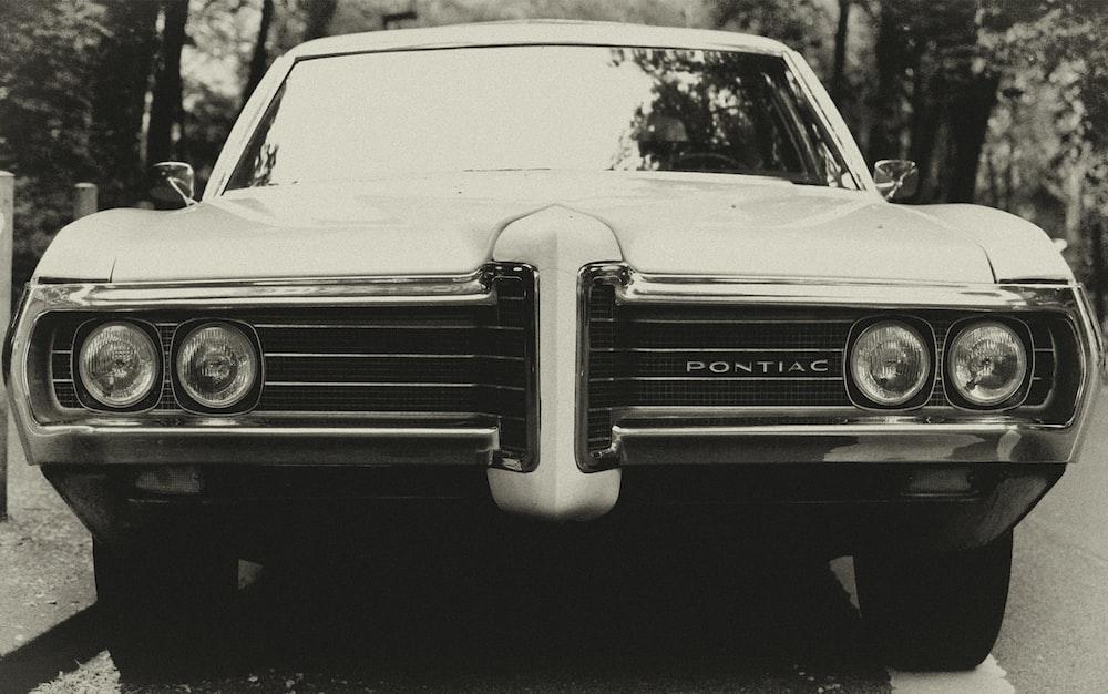 black Pontiac car on gray road