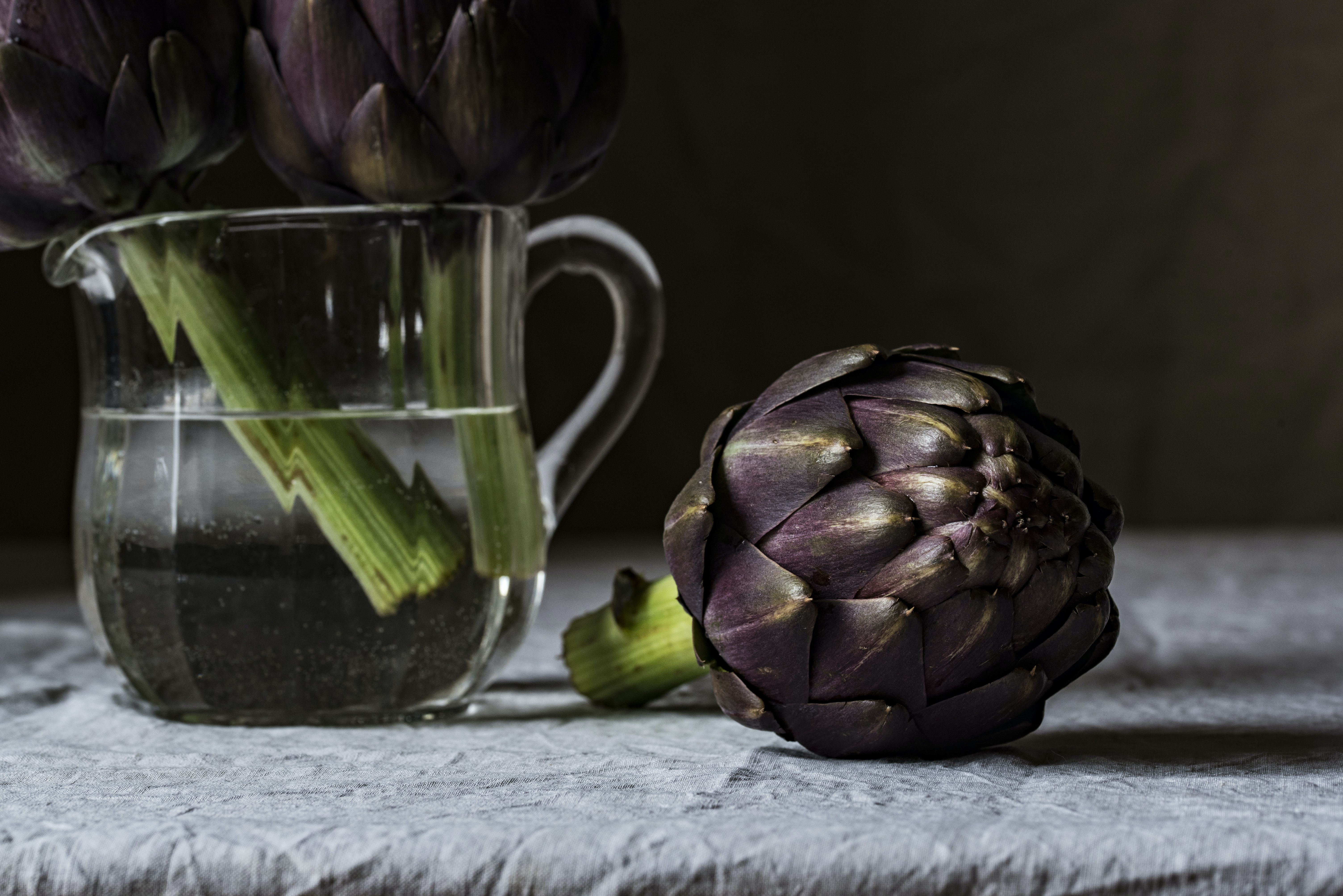 Purple artichoke in a jug of water