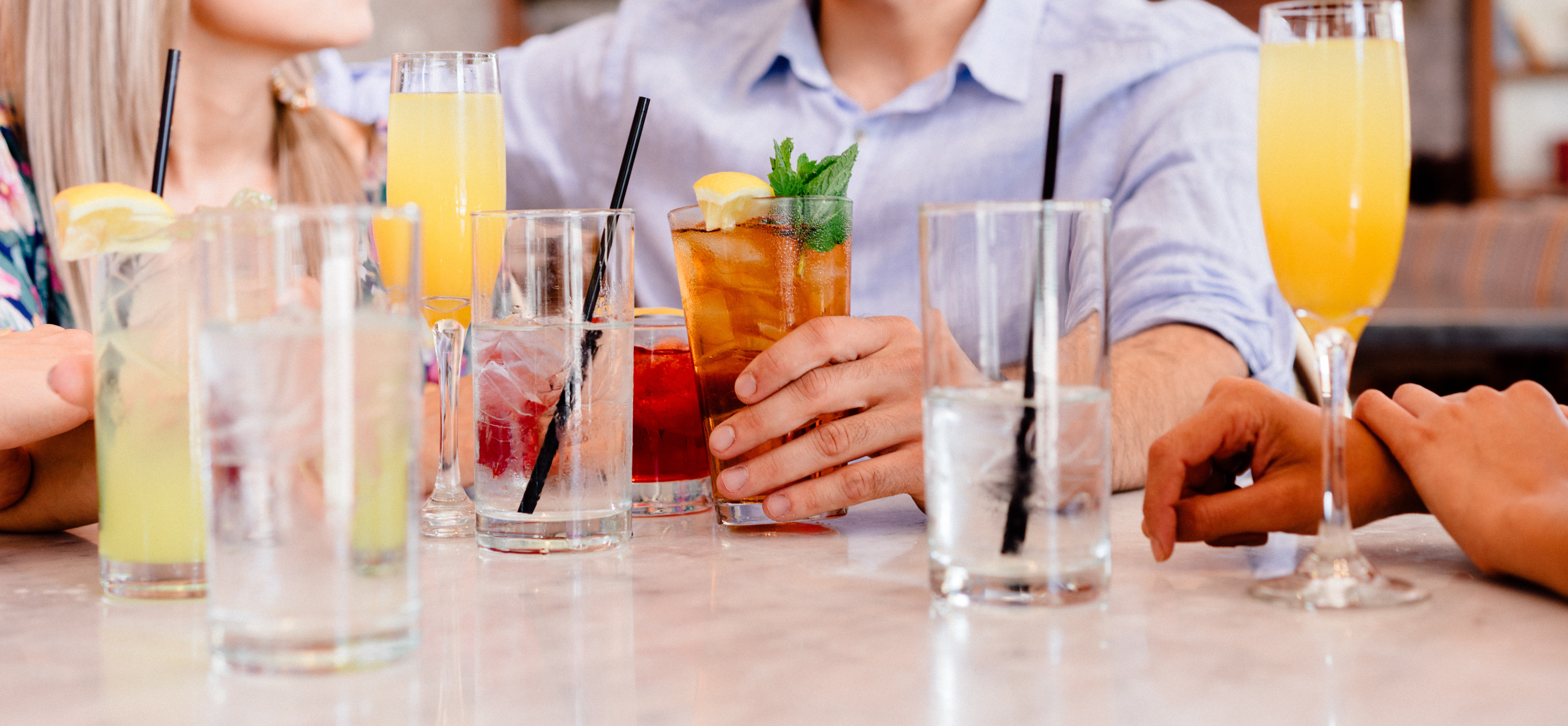 A group of friends sitting at a table with drinks