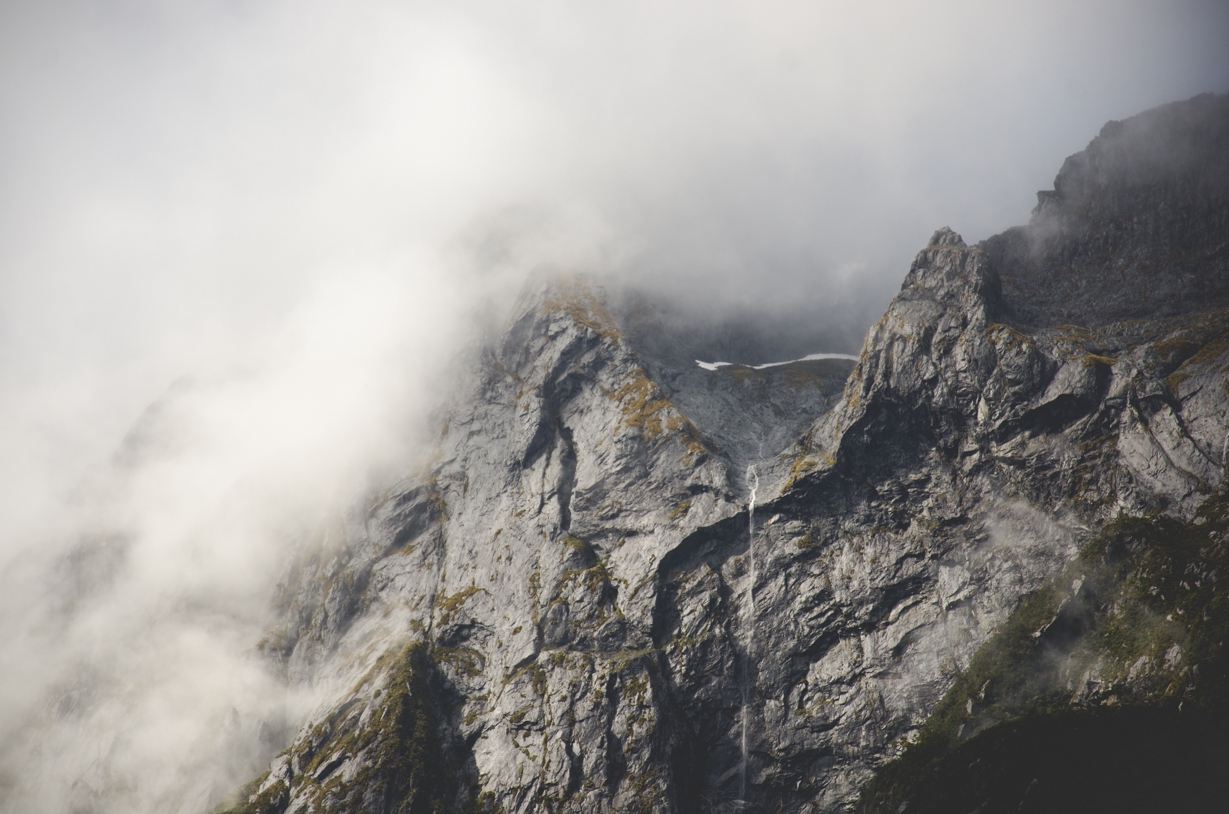 Gray rocky mountainside in Milford Sound