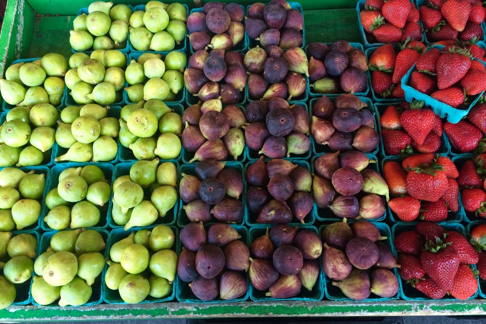 strawberry, fig, and green fig on display