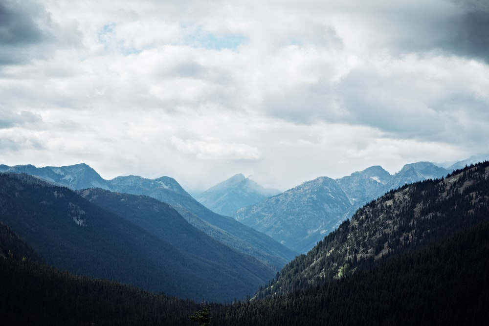 mountains under cloudy skies