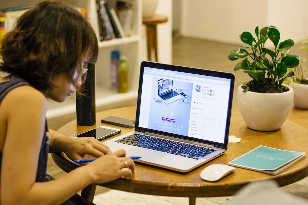 woman browsing on her laptop