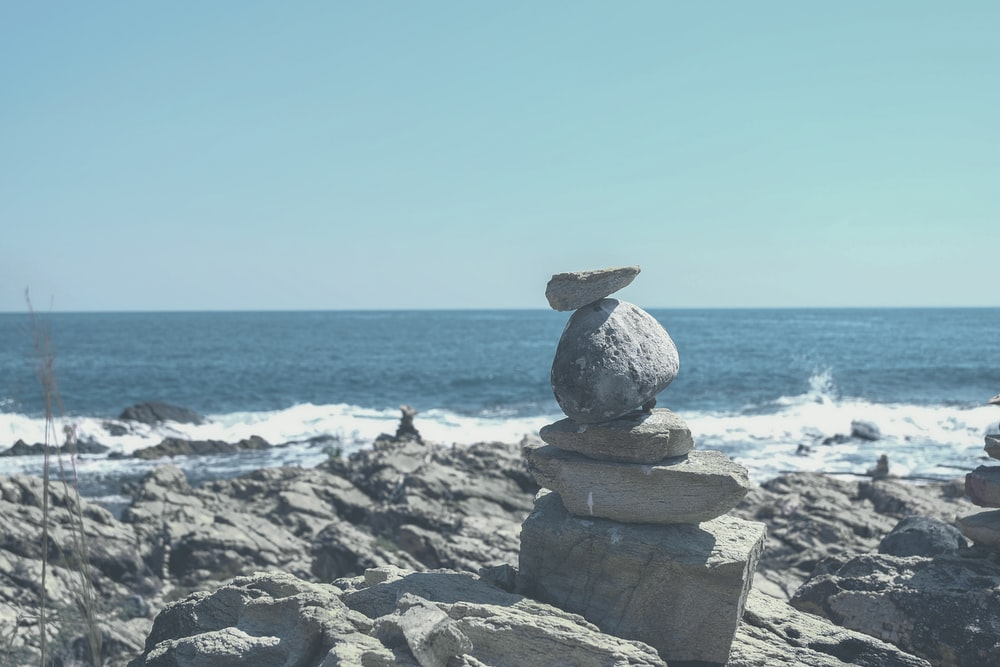 gray stone formation on beach