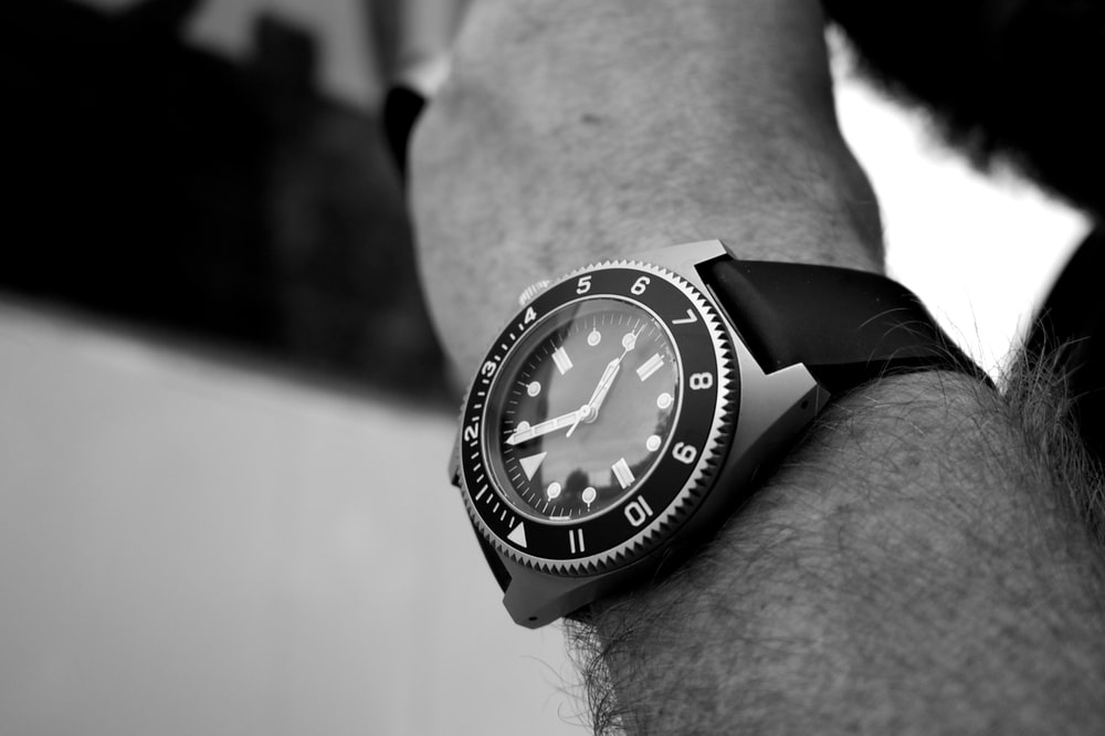 grayscale photography of analog watch