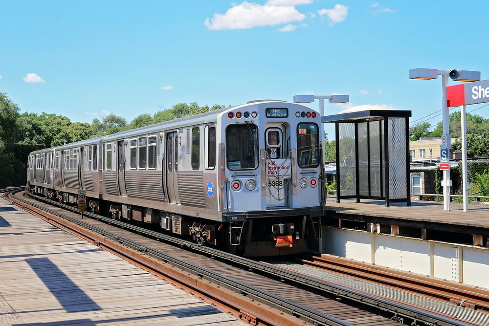 silver train near station