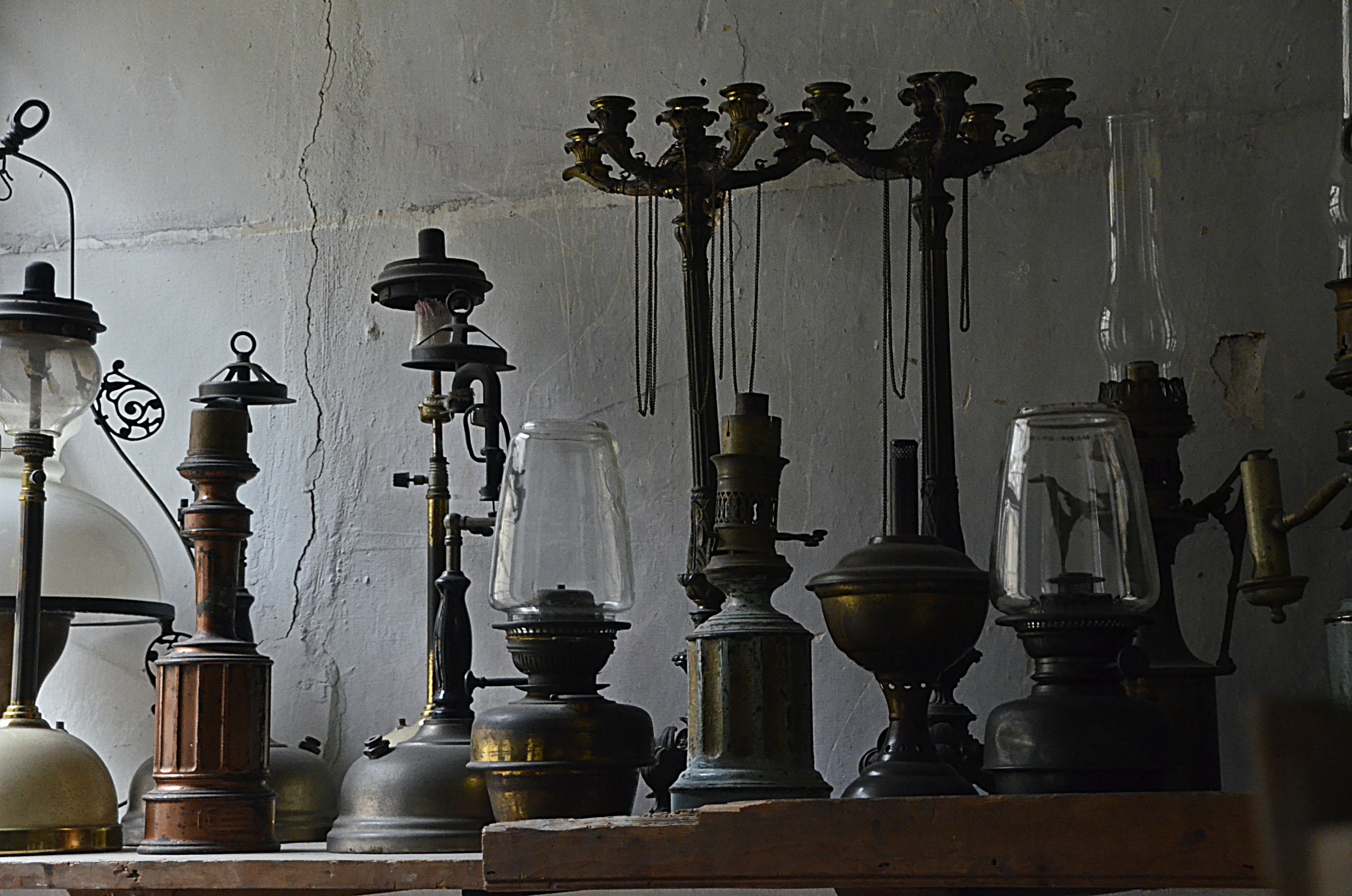 brass-colored oil lamps on top of table