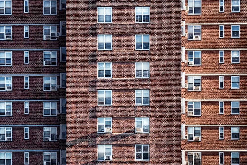 brown brick high-rise building