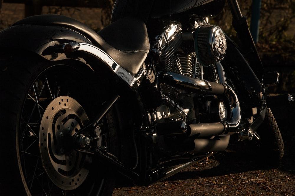 black cruiser motorcycle near green bush