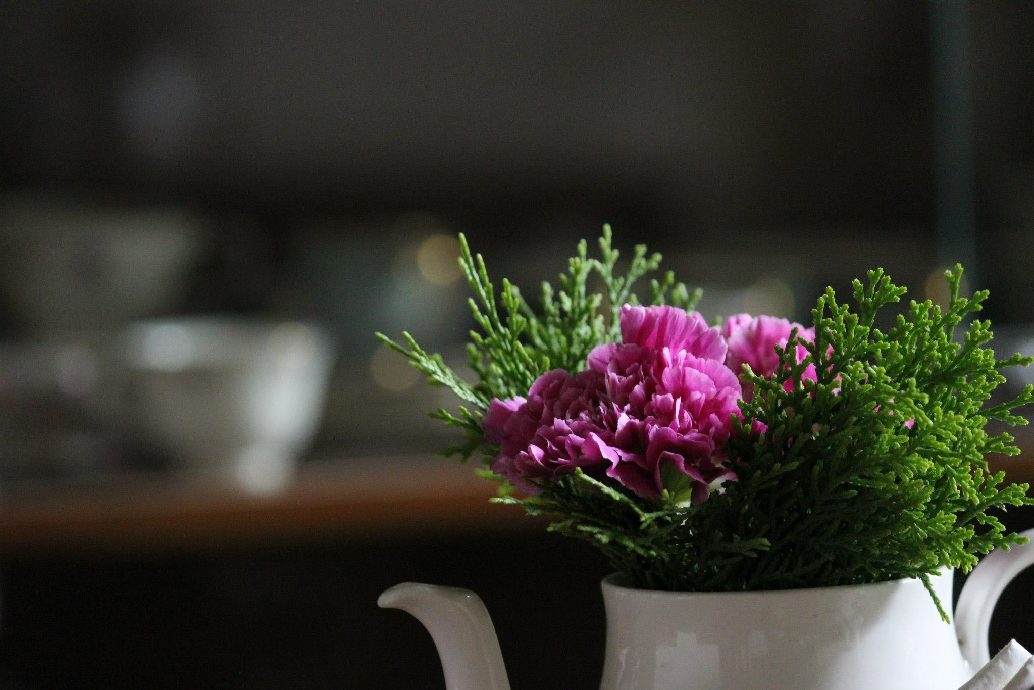 Close-up of a bunch of purple flowers in a teapot