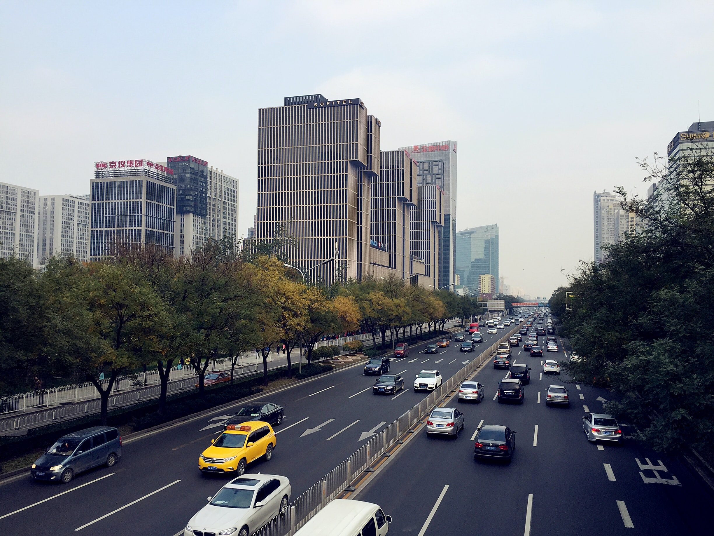 Urban highway with skyscrapers and busy traffic during the day in Guomao