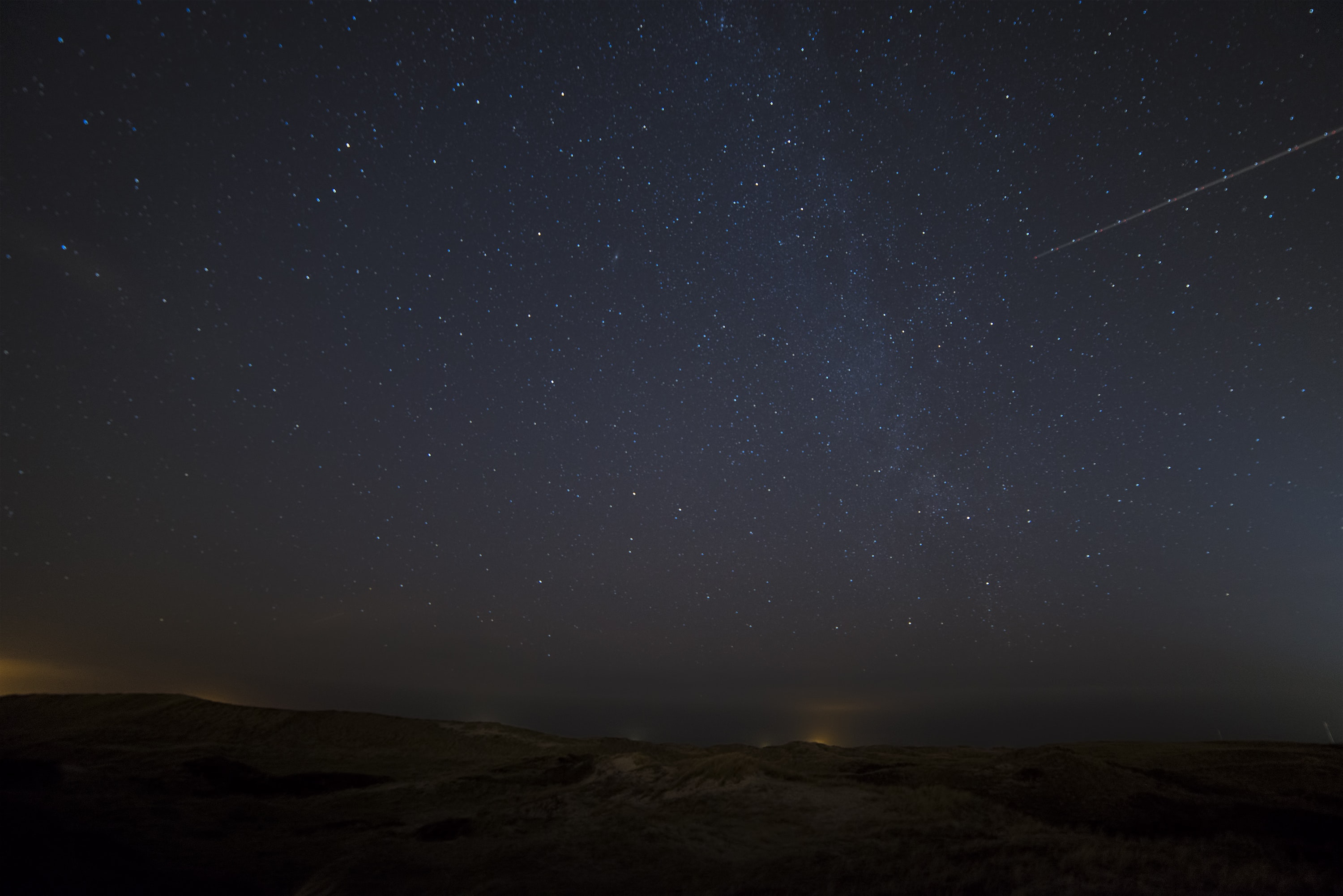 landscape photograph of meteor falling in the sky