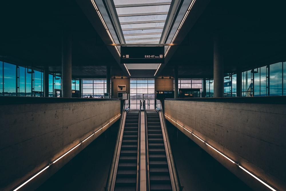 black and brown escalator inside building