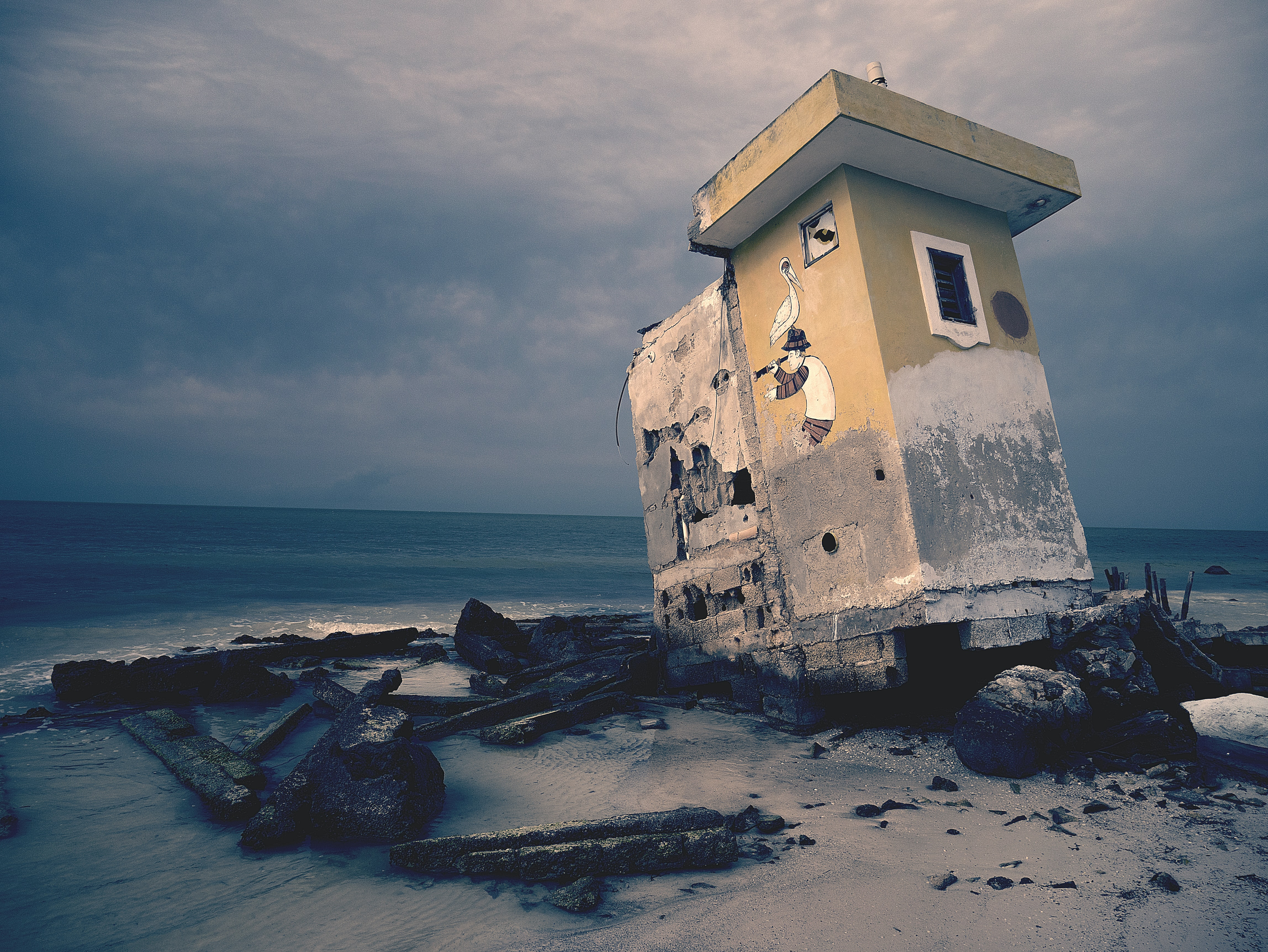 An abandoned and derelict structure on the beach.