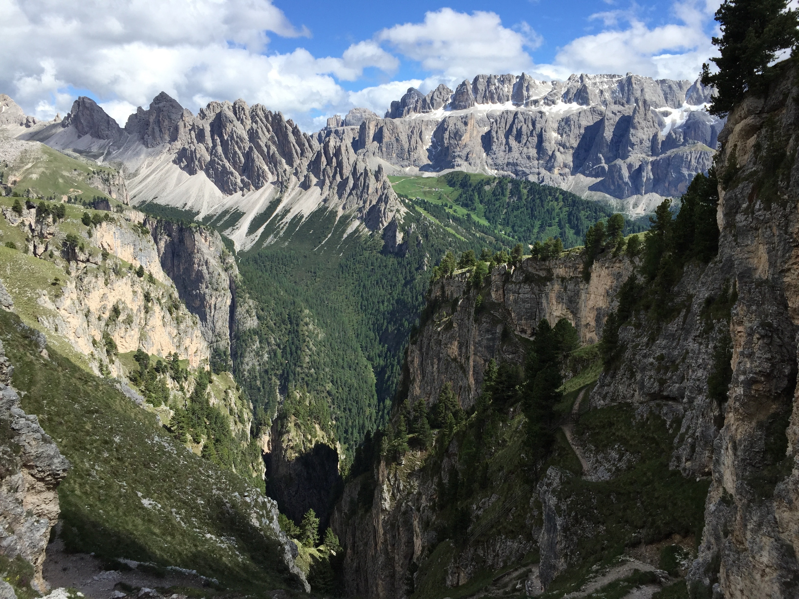 A deep gorge among tall jagged mountains