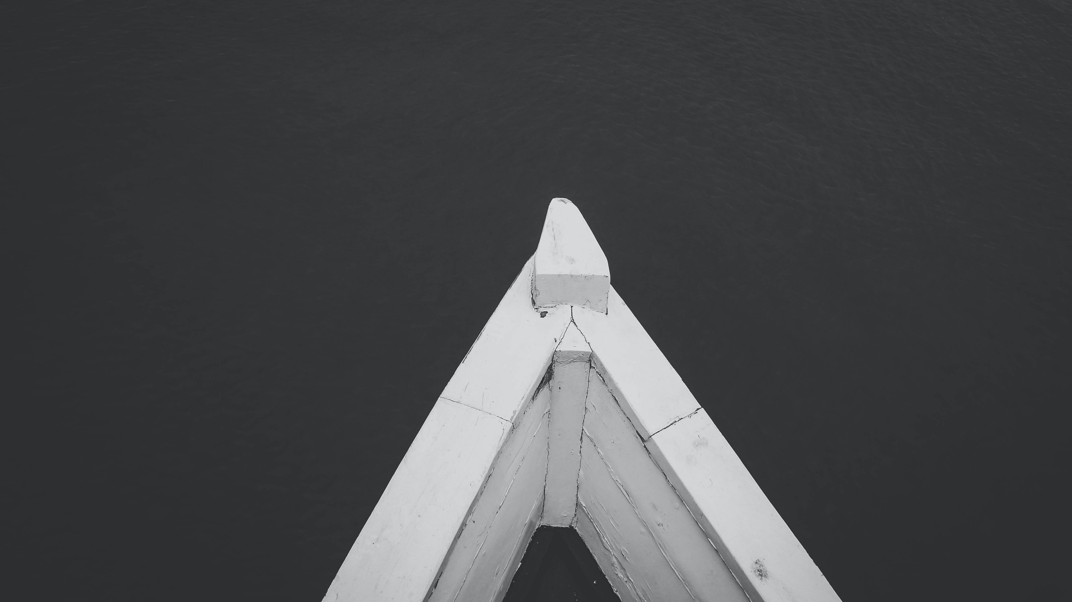 Front of a rowboat forms a triangle in the water