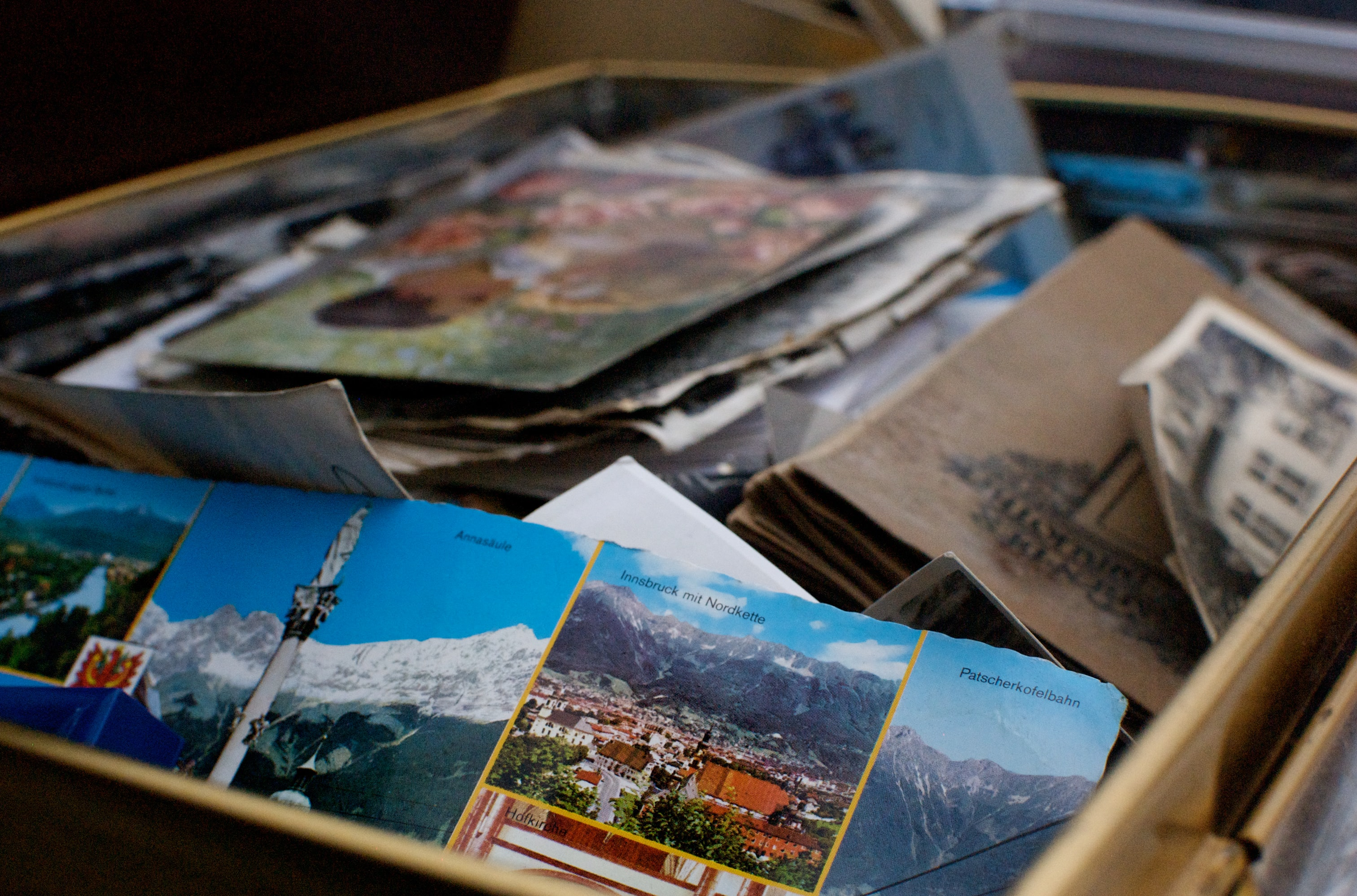 A box full of german literature, scraps of paper, and tourist leaflets in a box