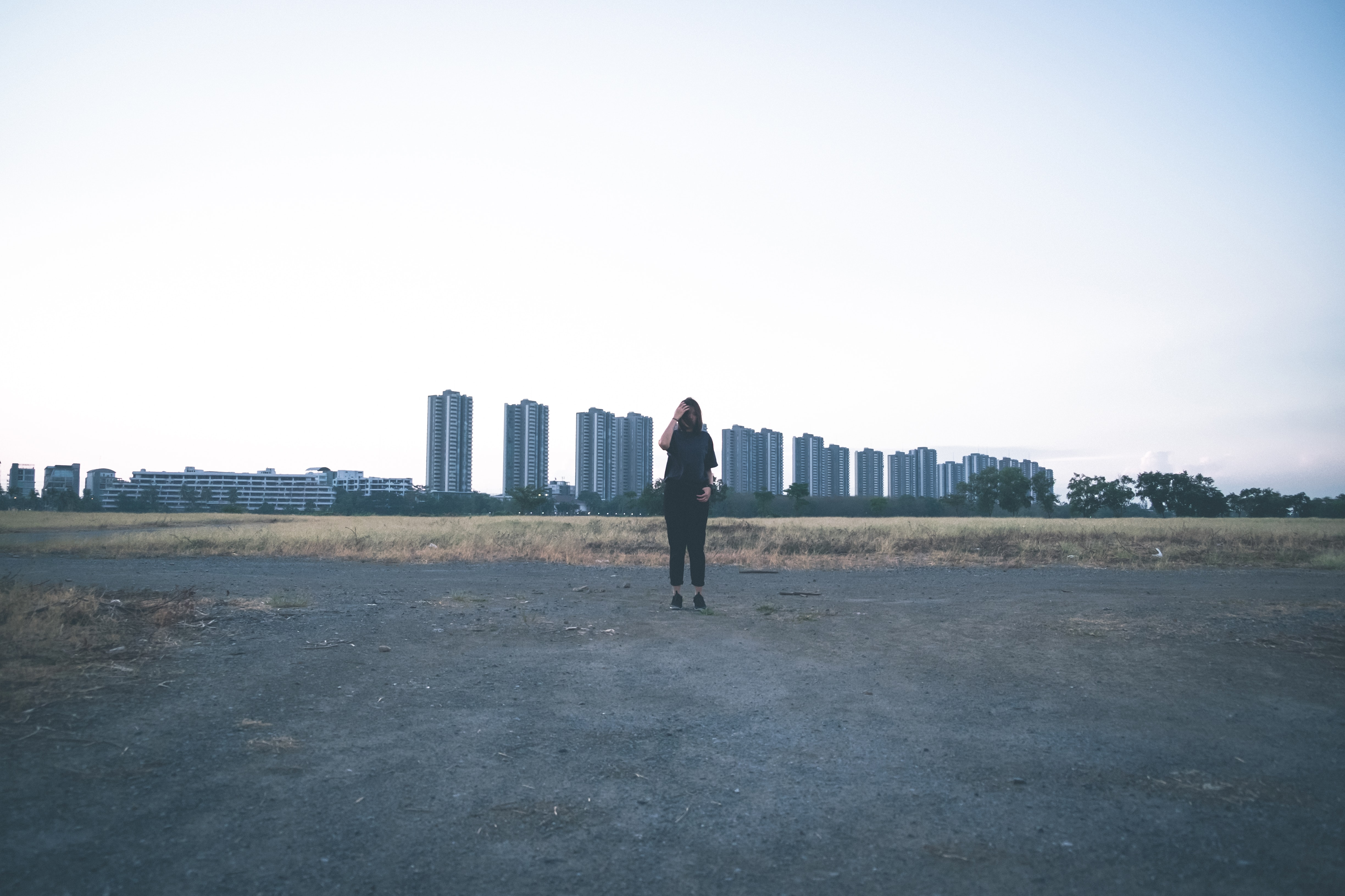 woman wearing black shirt and pants standing on field during daytime