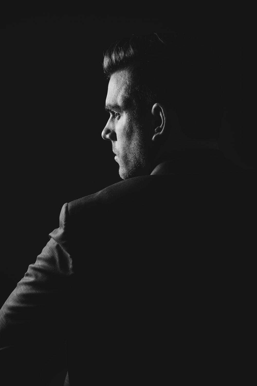 grayscale photo of man wearing blazer