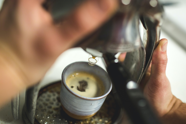 selective focus photography of coffee mug