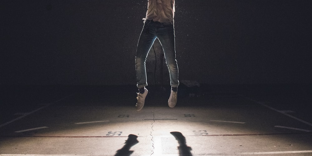 person jumping on surface
