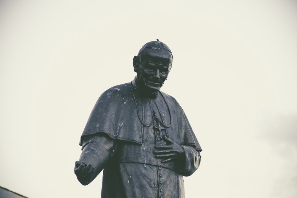 black concrete Pope John Paul statue during daytime