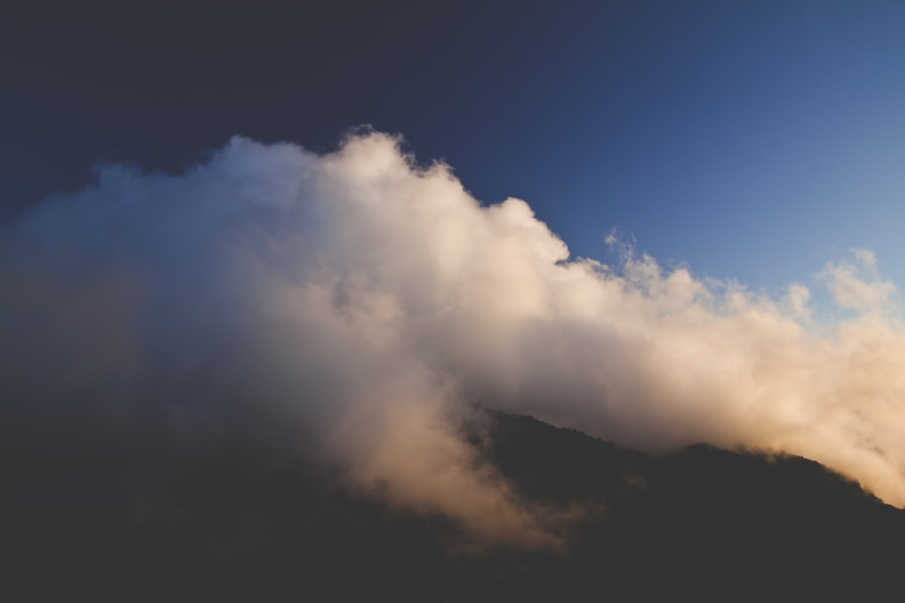 mountain top with white clouds