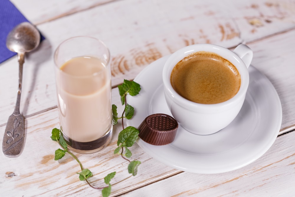 white ceramic teacup set and glass of milk on table