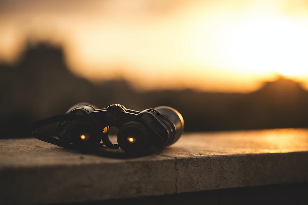 close-up selective focus photo of black binoculars