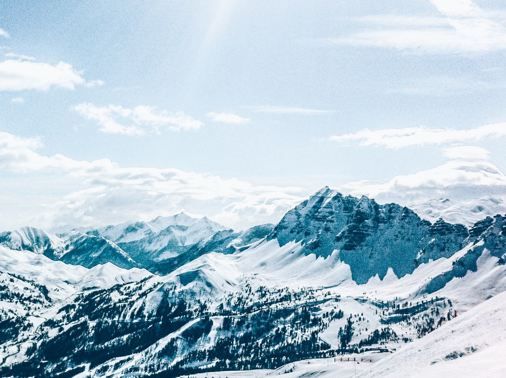 snow-covered mountain at daytime