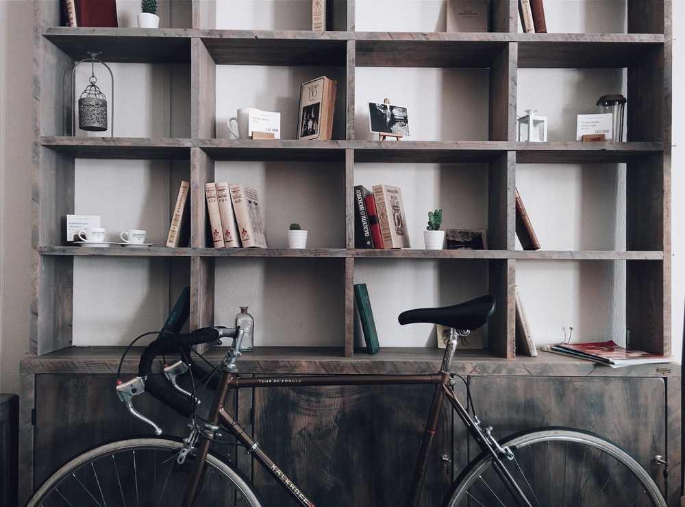 bicycle leaning on shelf