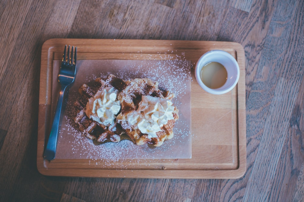 sugar glazed waffle topped with cream