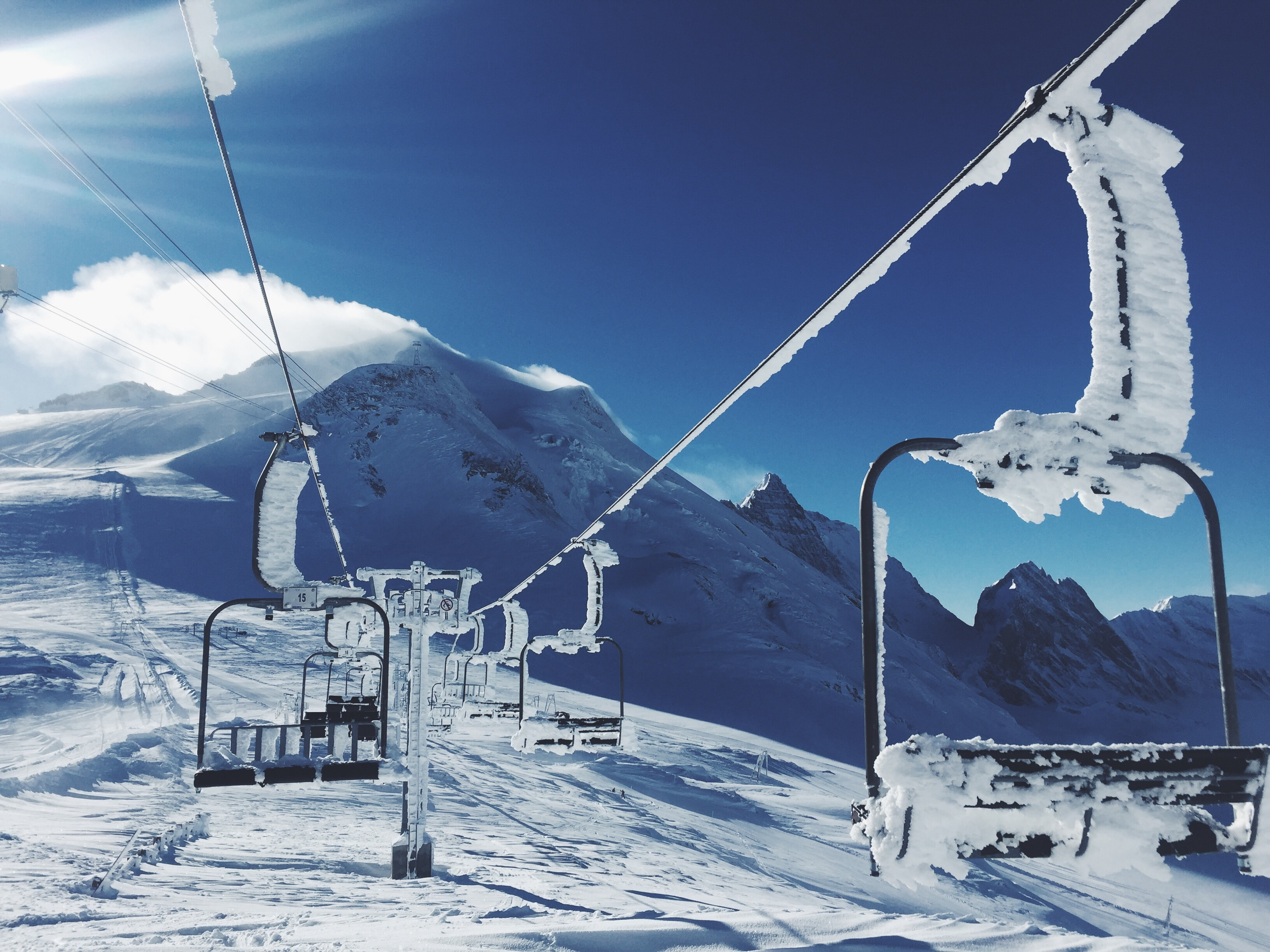 Snow covered ski lifts stopped on a snowy mountain