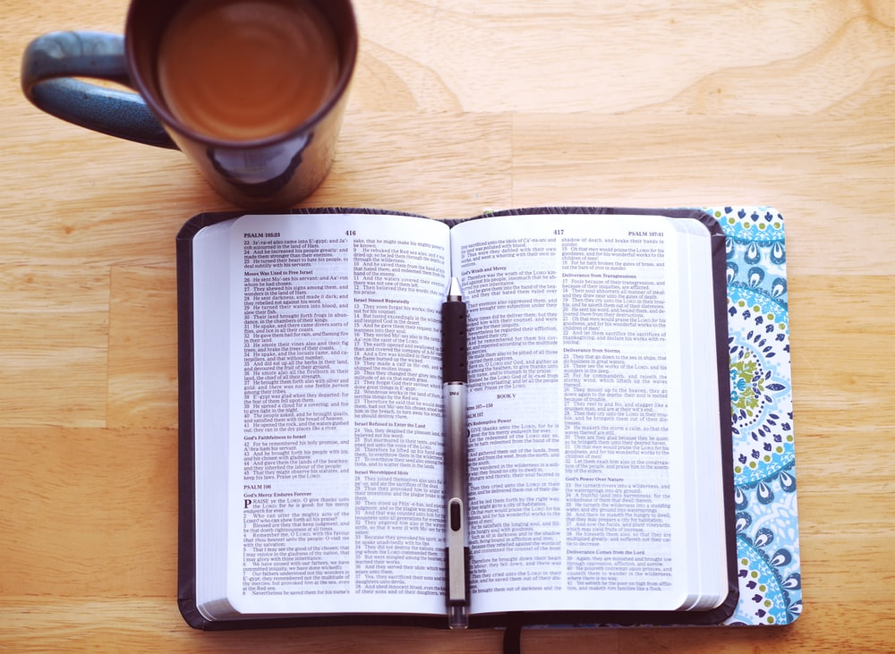 flat lay photography of bible