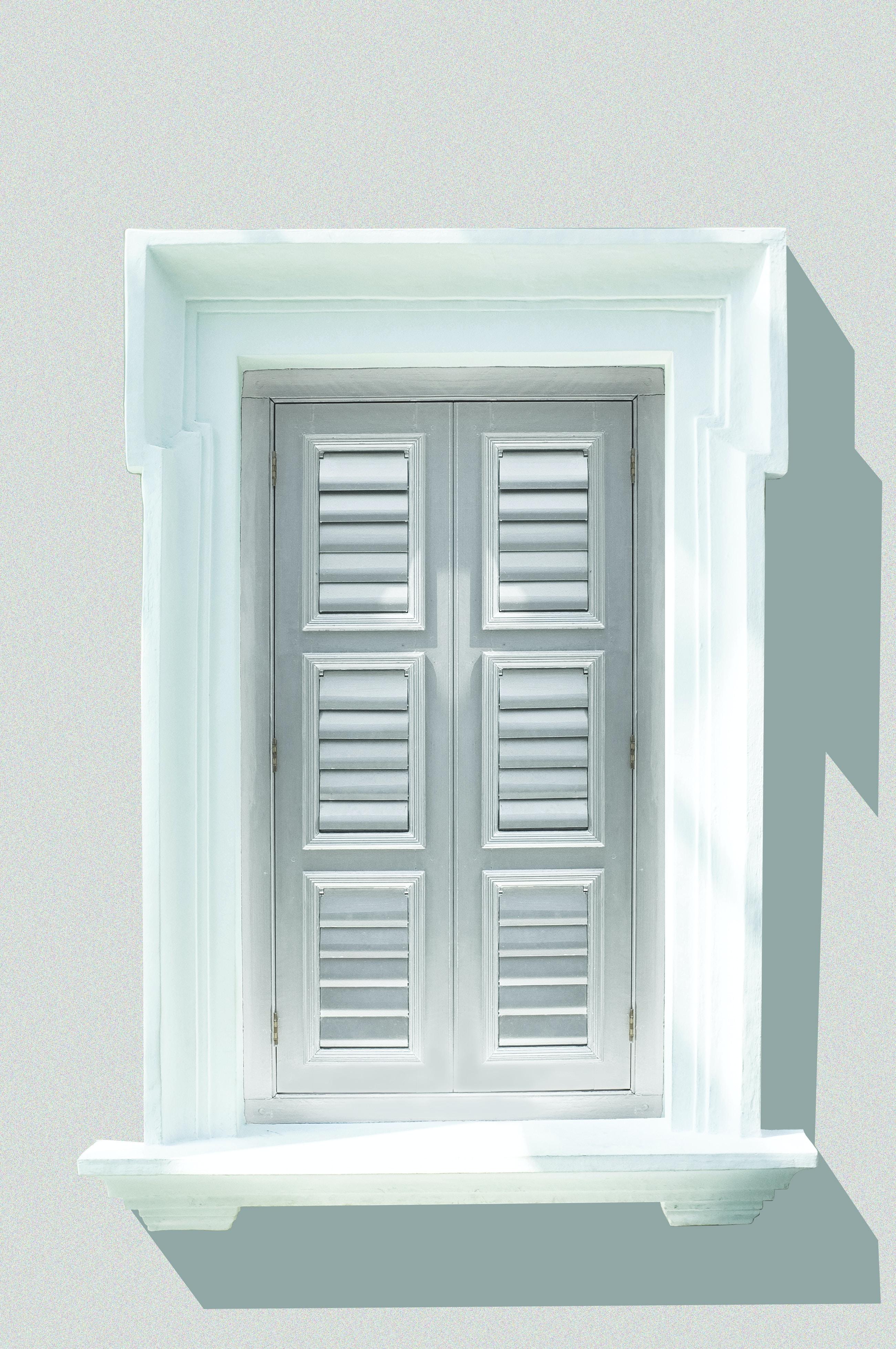 white wooden window shutter